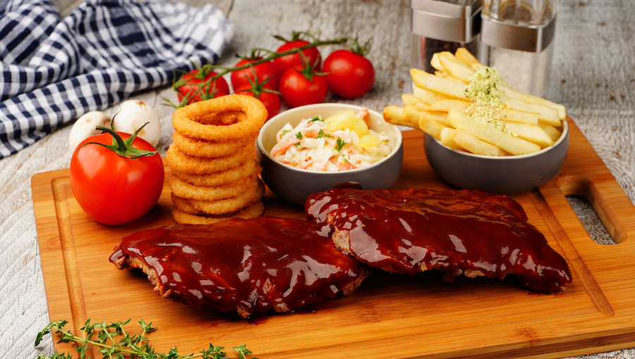 [B]Hot Tomato[/B] [BR]Sharing is caring, although you may not want to with this steakhouse's made-for-sharing Full Slab Baby Back Ribs, $32, which are glazed with a homemade barbecue sauce and served with grilled tomato, a side of onion rings, parmesan fries, and pineapple coleslaw.